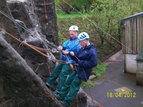 Paul Smart and Andrew Lindell abseiling at The Calvert Trust, Exmoor