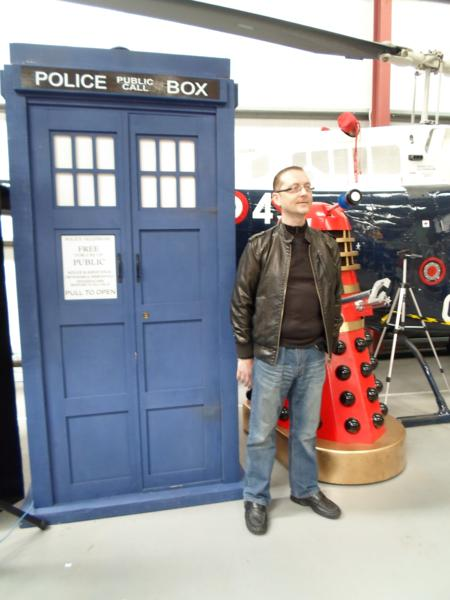 Nick stood outside The Tardis, Dalek in background