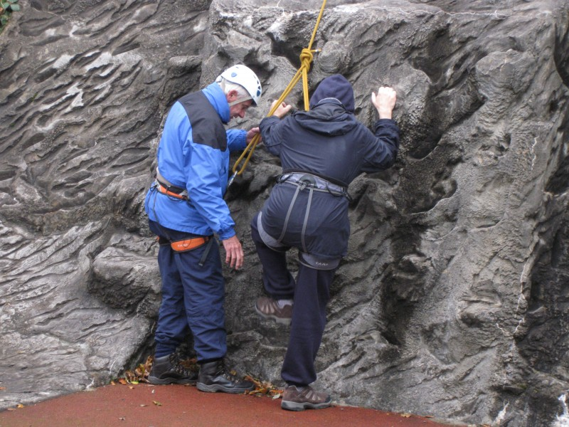 Spud helping James to begin the rock climbing