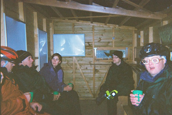 Having a warm and a cup of tea in he hut during our cycling trip
