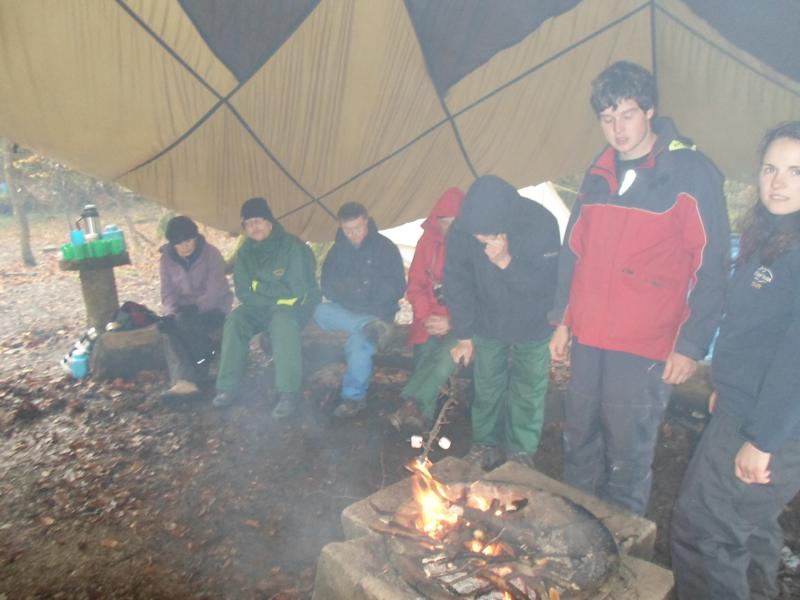 Becky, Nick, Andrew, James & Oli, coping with the smoke whilst cooking the marshmallows& Rebecca looking on