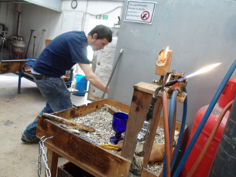 Showing the area where the glass is taken from the iron and the bunson burner they use