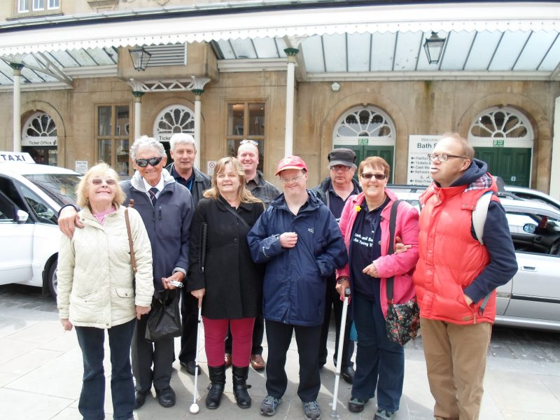 Sylvia, Harry, Spud, Julie, Paul, Andrew, Ernest, Kym & James outside Bath Spa railway station
