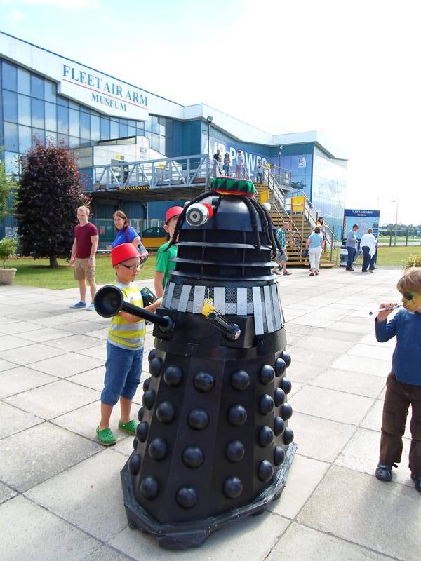 Children inspecting a Dalek outside