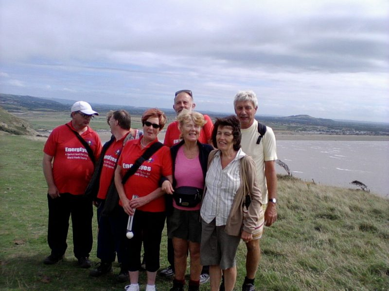 Ernest, Phyllis, Andrew, Jean, Phillip, Aileen, Eileen, Spud on top of Brean Down with Brean Sands in the background