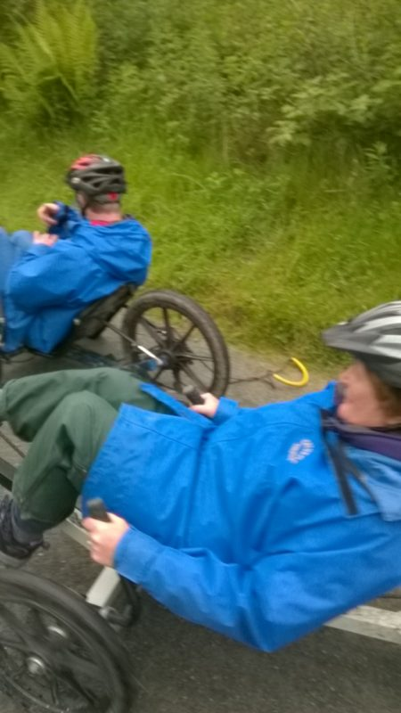Andrew and Jean racing downhill on their Recumbent Bikes.