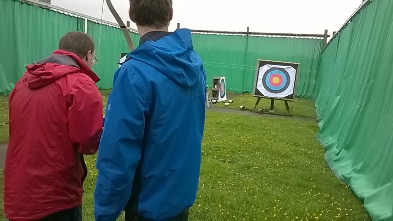 Alun helping Andrew to stay on target.