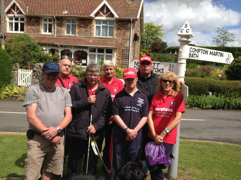 Andy Gill, Phillip, Ernest, Orla, Spud, Andrew, Matthew and Aileen stood by the signpost on Ubley Green
