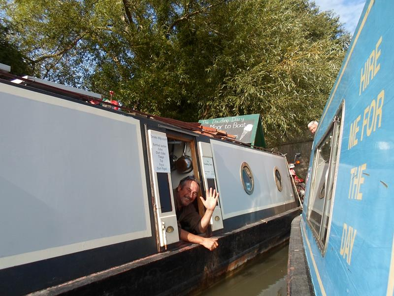 Saying goodbye to the lovely gentleman we met who owns the Dawdling Dairy after purchasing teas, coffees and ice cream from his floating cafe.