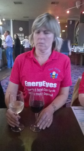 Su Camper in Wetherspoons, V- Shed, Bristol looking very puzzled as to why she has a white wine and a red wine!