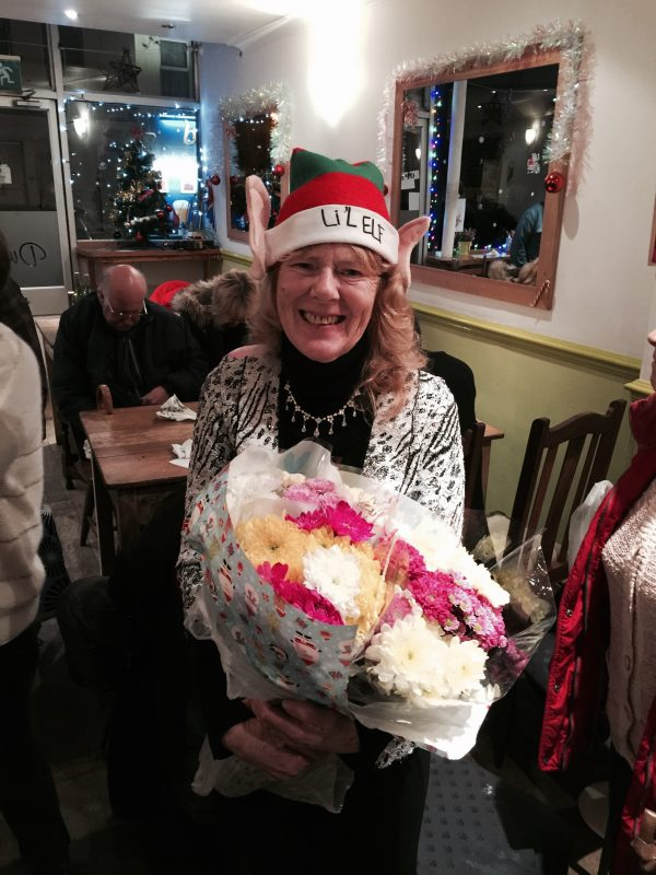 "Aileen receiving her gorgeous bunches of flowers as a big ""Thank You"" from all the members. Wonderful!"