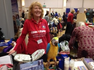 Aileen stood by the parrot on our stall