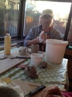 "Ernest cleaning his hands after moulding his ""mug"""
