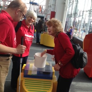 James & Janet and Aileen explaining to James how the bucket made a sound by pressing the button