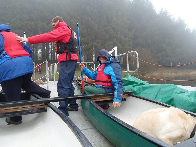 Alun helping Jayne into the canoe. James supervising!