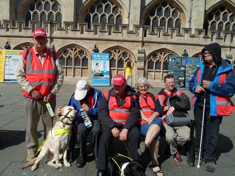Matthew, Robin, Harry, Ernest, Janet, Andrew and James outside Bath Abbey.