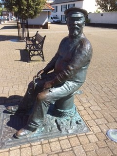 """A statue of John Short, """"Yankee Jack"""" on the harbourside at Watchet"""