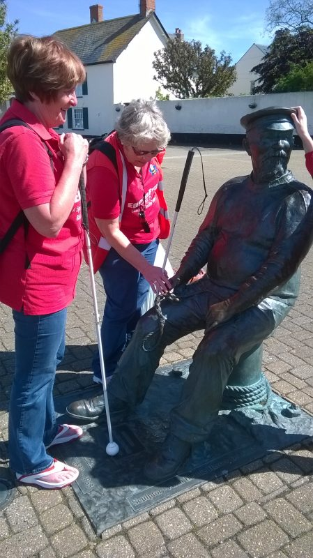 Jean and Ann, touching the artwork, of Yankee Jack. Very tactile sculpture