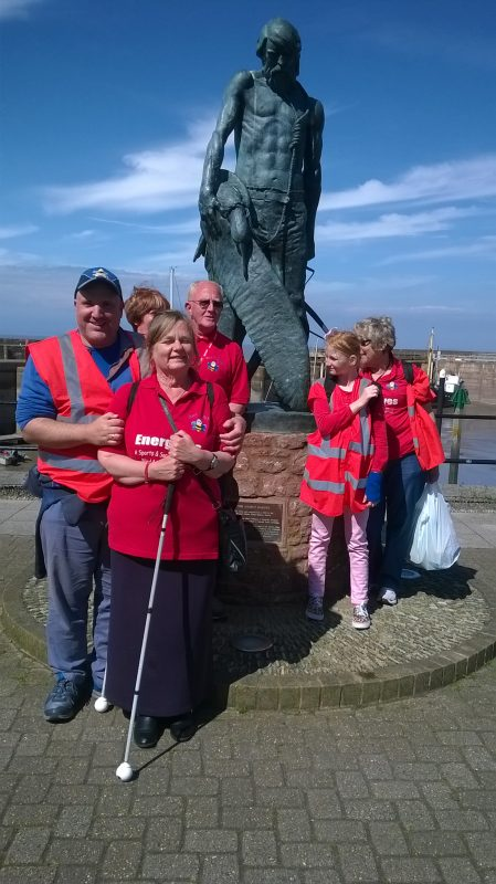 John, Julie, Jean, Bryan, Sarah and Ann stood in front of the statue of The Ancient Mariner on Watchet's Harbour front