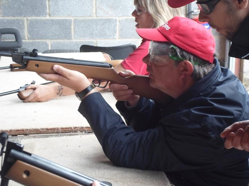 Ernest firing his rifle.