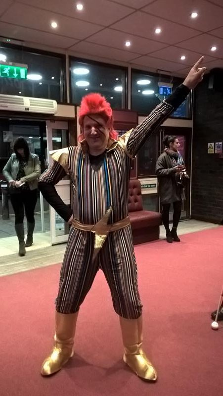 JOHN ALEXANDER POSING AS DAVID BOWIE INSIDE THE ENTRANCE OF THE PLAYHOUSE, WESTON-SUPER-MARE. WHAT A STAR!!!
