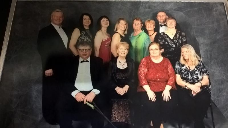 STEVE, SU DIBBEN, CLARE, ANGELA, PHYLLIS, ANNIE, PHILLIP AND SU CAMPER. ERNEST & ORLA, AILEEN AND JAYNE FRONT ROW