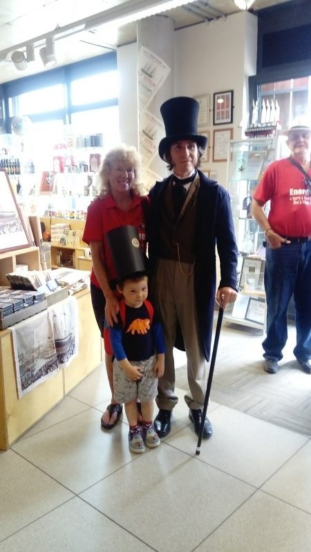 AILEEN, MAX & ISAMBARD KINGDOM BRUNEL INSIDE THE ENTRANCE TO THE SS GREAT BRITAIN SHOP.