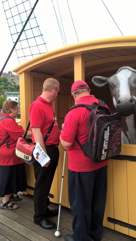 JAYNE, PAUL & ERNEST LISTENING TO THE COWS AND THE PIGS ON THE DECK OF SS GREAT BRITAIN