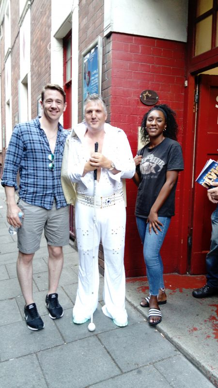 JOHN AT THE STAGE DOOR WITH TWO OF THE CAST.