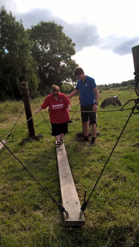JAYNE BEING HELPED BY ALISTAIR ACROSS THE PLANK. IT IS VERY WOBBLY!!