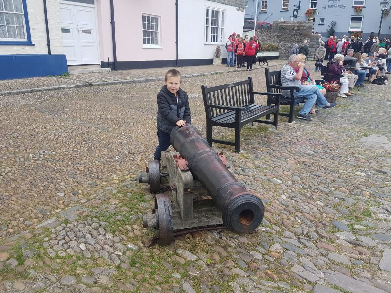 MAX HOLDING A CANNON