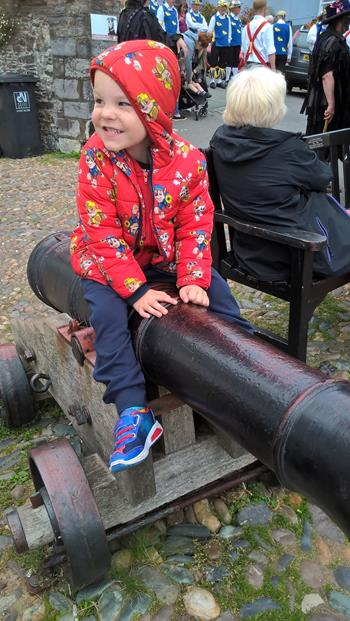 SAM SITTING ON ONE OF THE SMALLER CANNONS