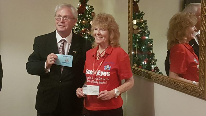 ALAN JONES PRESENTING A CHEQUE TO AILEEN, ENERGEYES'S CHAIRMAN