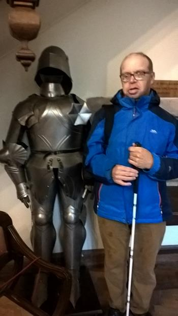 JAMES STOOD BY A KNIGHT IN ARMOUR