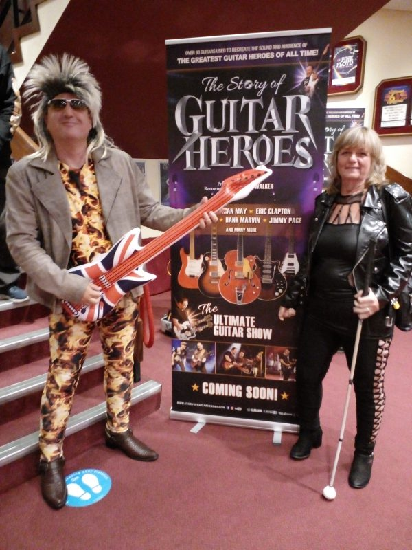 ROCK STAR AND ROCK CHICK STOOD BY THE POSTER IN THE PLAYHOUSE THEATRE,  WESTON-SUPER-MARE